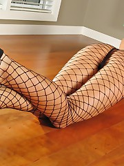 Glorious chick in fishnets shoves her fingers deep inside of her young tight wet pussy