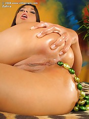 Stunning tanned chick with pearls in her gaping young tight wet pussy