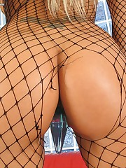 Dirty blonde slut in fishnets shows her gaping shaved pussy close up
