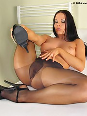 Gorgeous dark haired naughty chick shows her great shaved pussy close up